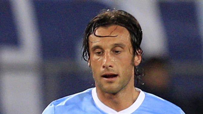 FILE -- In this April 7, 2012 file photo, Lazio's captain Stefano Mauri is seen in action during a Serie A soccer match between Lazio and Napoli, at Rome's Olympic stadium. Mauri was among more than twelve arrested as part of a wide-ranging investigation into max-fixing in football, Monday, May 28, 2012. Italian authorities also swept through the Italy national team training site near Florence, and are investigating Italy and Zenit St Petersburg defender Domenico Criscito a week before the national team leaves for the European Championship in Poland and Ukraine, and the coach of Italian champion Juventus, Antonio Conte for his alleged wrongdoing while coach of Siena. (AP Photo/Riccardo De Luca)