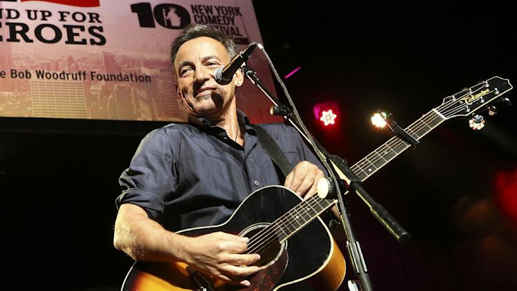 "FILE - In this Nov. 6, 2013 file photo, musician Bruce Springsteen performs at the Stand Up for Heroes event at Madison Square Garden, in New York. The Boss himself will close out three days of performances in Dallas that will keep NCAA Final Four fans rocking. Andrew Dost of the pop-rock trio fun., which will take the stage before Bruce Springsteen and the E Street Band on Sunday, April 6, 2014, says, ""I'm really excited just for the energy that will be in town, to be part of that energy."" (John Minchillo/Invision/AP, file)"
