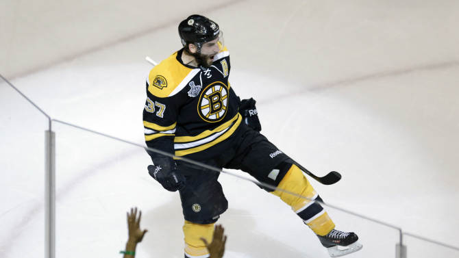Boston Bruins center Patrice Bergeron celebrates his goal against the Chicago Blackhawks during the second period in Game 3 of the NHL hockey Stanley Cup Finals in Boston, Monday, June 17, 2013. (AP Photo/Charles Krupa)