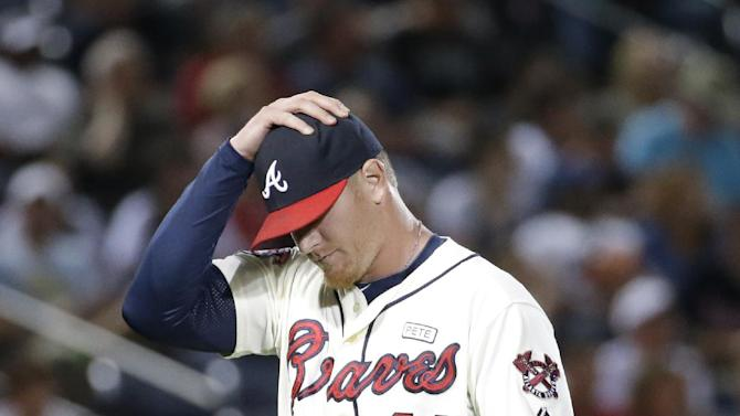 Atlanta Braves relief pitcher David Carpenter walks off the mound into the dugout during a baseball game against the New York Mets, Saturday, Sept. 20, 2014, in Atlanta. (AP Photo/David Goldman)