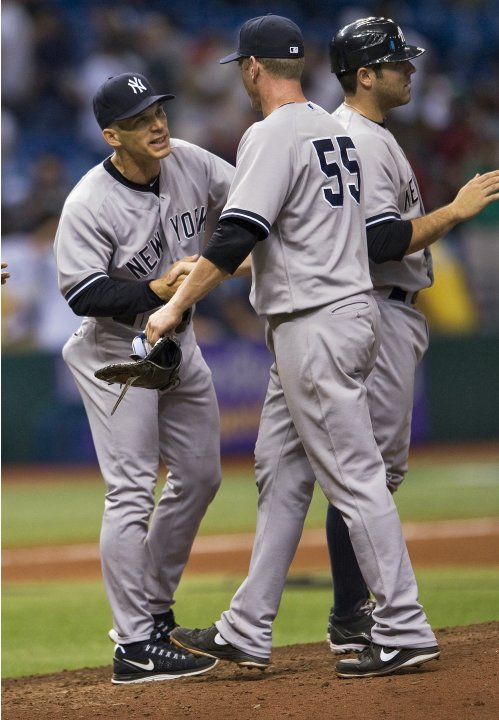 Yankees manager Girardi celebrates with Overbay after beating the Rays in MLB game in St. Petersburg