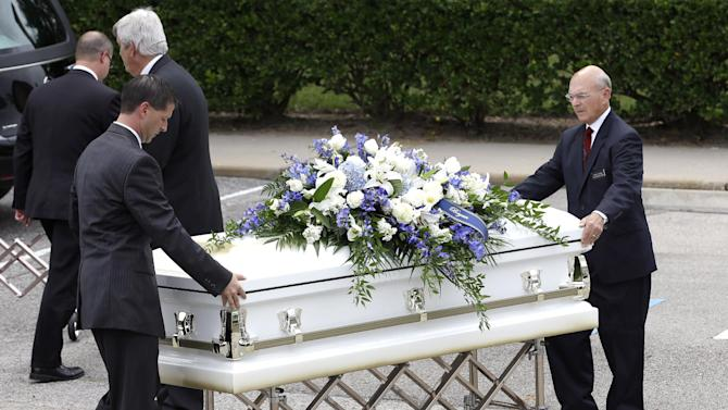 One of six caskets is moved into The Church of Jesus Christ of Latter-day Saints for a funeral service for members of the Stay family Wednesday, July 16, 2014, in Houston. Slaying victims Stephen Stay, 39, his 34-year-old wife, Katie, and their four youngest children were shot to death last week in their suburban Houston home. The oldest child Cassidy, 15, survived the attack by playing dead, called police and identified her uncle, 33-year-old Ronald Lee Haskell, as the gunman. Funeral services will be held later today. (AP Photo/David J. Phillip)
