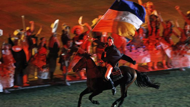 A performer rides a horse during opening ceremony of the 10th South American Games in Santiago