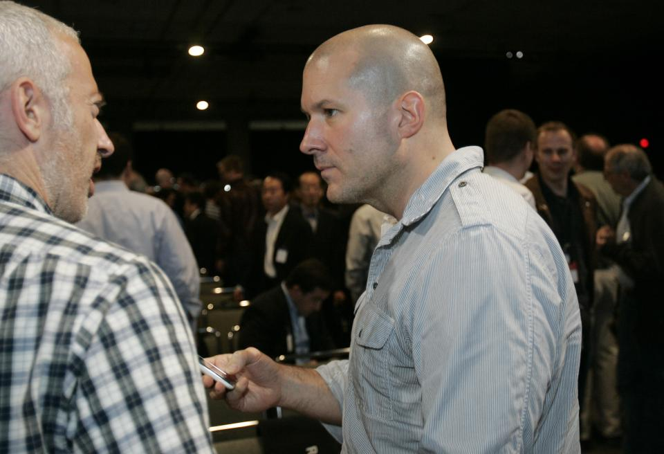 In this June 8, 2009 photo shows Apple Jonathan Ive, right, Apple senior vice president of Industrial Design, during an Apple meeting in San Francisco. (AP Photo/Paul Sakuma)