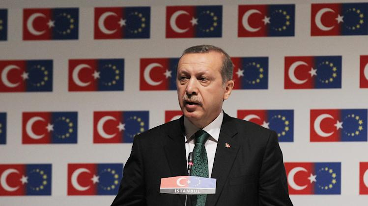 "Turkish Prime Minister Recep Tayyip Erdogan delivers a speech during a conference in Istanbul on Friday, June 7, 2013. A senior European Union official on Friday criticized Turkish police's harsh crackdown on protesters told an audience including Erdogan that a ""swift and transparent"" investigation was needed. (AP Photo/Thanassis Stavrakis)"