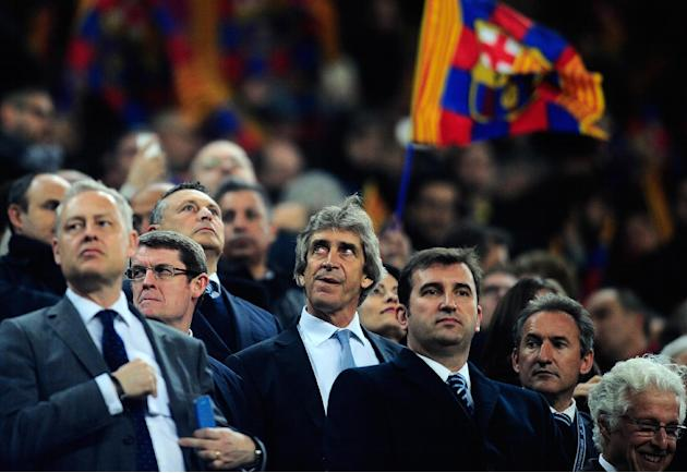 Manchester City's manager Manuel Pellegrini, center, on the stands, waits for the start of the Champions League, round of 16, second leg, soccer match between FC Barcelona and Manchester City at t
