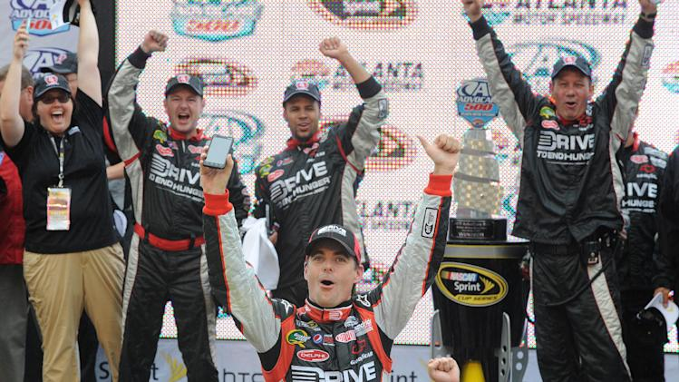 Driver Jeff Gordon, center, celebrates in victory lane after winning the NASCAR Sprint Cup AdvoCare 500 auto race, Tuesday, Sept. 6, 2011, at the Atlanta Motor Speedway, in Hampton, Ga. (AP Photo/Erik S Lesser)