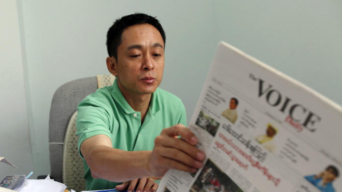 Kyaw Min Swe, chief editor in The Voice newspaper, holds a copy of his daily during an interview with the Associated Press in his office in Yangon, Myanmar, Sunday, March 31, 2013. The reform process under President Thein Sein, who took office two years ago this month, has included the abolition of direct censorship of local media. On Monday, independent daily newspapers will be able to publish for the first time since 1964. (AP Photo/Khin Maung Win)
