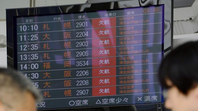 A bulletin board shows flights are canceled as a runway is closed, at Sendai Airport in Sendai, northern Japan Tuesday, Oct. 30, 2012. The airport has been closed after an unexploded bomb believed to be from World War II was found. (AP Photo/Kyodo News) JAPAN OUT, MANDATORY CREDIT, NO LICENSING IN CHINA, FRANCE, HONG KONG, JAPAN AND SOUTH KOREA