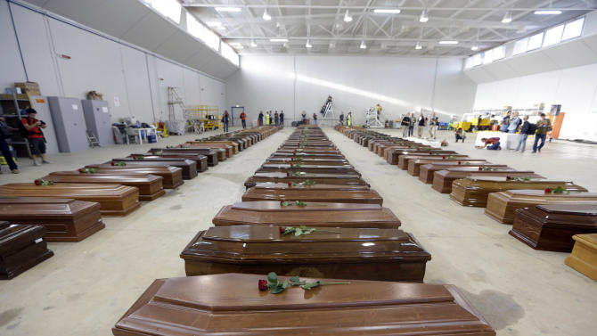 The coffins of 111 died migrants are lined up inside an hangar of Lampedusa's airport, Italy, Saturday, Oct. 5, 2013. A ship carrying African migrants towards Italy capsized Thursday off the Sicilian island of Lampedusa after the migrants on board started a fire to attract attention. Just 155 people survived, 111 bodies have been recovered and more than 200 are still missing. The tragedy has prompted outpourings of grief and calls for a comprehensive EU immigration policy to deal with the tens of thousands fleeing poverty and strife in Africa and the Middle East. (AP Photo/Luca Bruno)