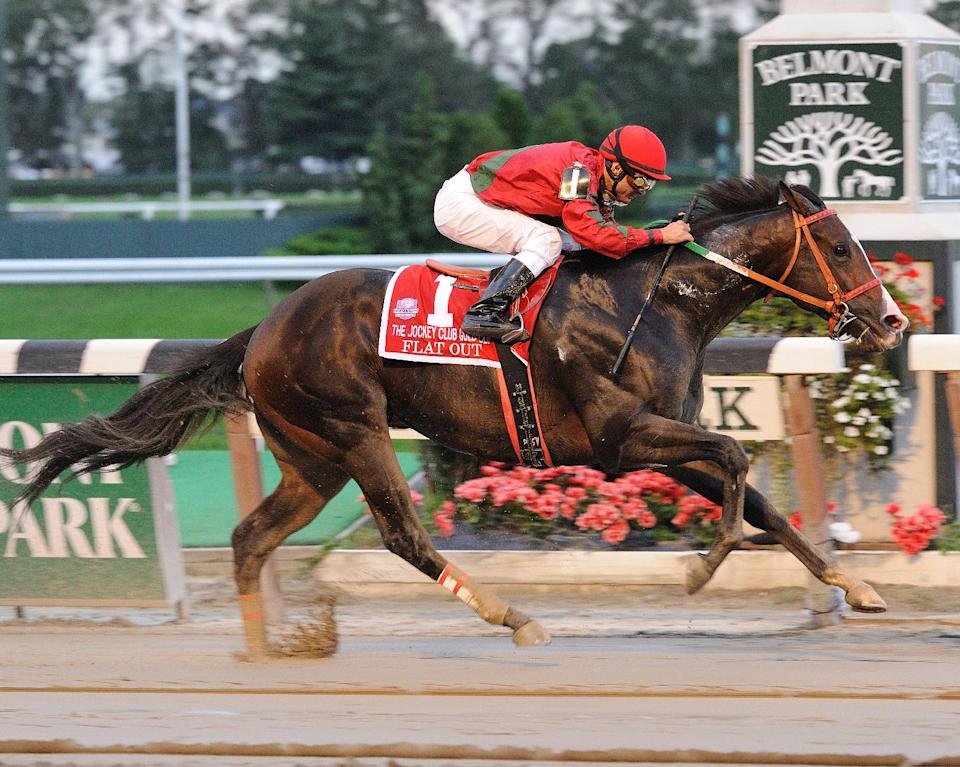 In this photo released by the New York Racing Association, Flat Out, ridden by Alex Solis, captures The Jockey Club Gold Cup Invitational horse race at Belmont Park Saturday, Oct. 1, 2011 in Elmont, N.Y. (AP Photo/New York Racing Association)