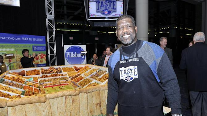 """Pro Football Hall of Fame member Randall McDaniel poses with the Pillsbury Ultimate Snackadium, unveiled during theTaste of the NFL's """"Party with a Purpose"""" to support the fight against hunger on Saturday, Feb. 2, 2013 in New Orleans. (G. Newman Lowrance/AP Images for Pillsbury)"""