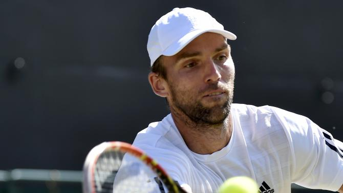 Ivo Karlovic of Croatia hits a shot during his match against Jo-Wilfried Tsonga of France at the Wimbledon Tennis Championships in London