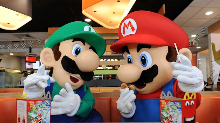 In this photo provided by Nintendo of America, Mario and Luigi enjoy Happy Meals on Saturday, July 12, 2014, in Los Angeles. Nintendo is celebrating the recently released Mario Kart 8 game for the Wii U console by partnering with McDonald's nationwide to include themed toys in the Happy Meal program. The program began on July 4 and is available while supplies last in stores until July 31. (AP Photo/Nintendo of America, Bob Riha Jr.) AP PROVIDES ACCESS TO THIS HANDOUT PHOTO TO BE USED SOLELY TO ILLUSTRATE NEWS REPORTING OR COMMENTARY ON THE FACTS OR EVENTS DEPICTED IN THIS IMAGE. THIS IMAGE MAY ONLY BE USED FOR 14 DAYS FROM TIME OF TRANSMISSION; NO ARCHIVING; NO LICENSING; NO SALES.