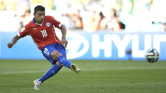 Chile's Gonzalo Jara takes the final penalty shot and misses giving Brazil the win during the World Cup round of 16 soccer match between Brazil and Chile at the Mineirao Stadium in Belo Horizonte, Brazil, Saturday, June 28, 2014. Brazil won 3-2 on penalties after a 1-1 tie