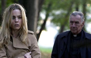 Melissa George and Philip Baker Hall in MGM's The Amityville Horror