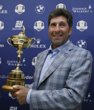 "European Ryder Cup captain José María Olazábal holds the trophy at a  press conference at Heathrow in London Tuesday, Oct. 2, 2012. Olazabal says being European Ryder Cup captain can be ""torture"" at times and he rules out staying on for another two years in the role. The Spaniard guided Europe to a 14½-13½ victory over the United States in a stirring comeback Sunday in Medinah, Illinois. (AP Photo/Kirsty Wigglesworth)"