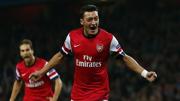 Arsenal's Mesut Ozil celebrates after scoring against Napoli (Reuters)
