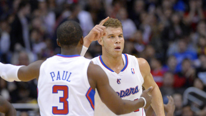 Los Angeles Clippers forward Blake Griffin, right, gestures after a Clippers basket as guard Chris Paul approaches during the first half of an NBA basketball game against the Utah Jazz, Sunday, Dec. 30, 2012, in Los Angeles. (AP Photo/Mark J. Terrill)