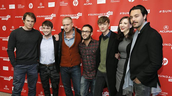 "Cast members from left, Michael C. Hall, Daniel Radcliffe, Ben Foster, director John Krokidas, Dane DeHaan, Erin Darke, and Jack Huston pose together at the premiere of ""Kill Your Darlings"" during the 2013 Sundance Film Festival on Friday, Jan. 18, 2013 in Park City, Utah. (Photo by Danny Moloshok/Invision/AP)"