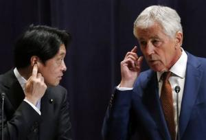 U.S. Secretary of Defense Chuck Hagel and his Japanese counterpart Itsunori Onodera attend their joint news conference in Tokyo