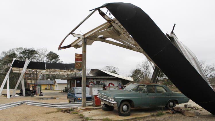 Large metal awnings sit ripped apart at Q's Car Wash in Centreville, Miss. on Wednesday, Dec. 26, 2012. More than 25 people were injured and at least 70 homes were damaged in Mississippi by the severe storms that pushed across the South on Christmas Day, authorities said Wednesday. (AP Photo/The Enterprise-Journal, Philip Hall)