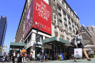 <p>               FILE - In this May 10, 2011 file photo, people carrying Macy's shopping bags walk past the Macy's flagship store, in New York. Macy's Inc. is reporting a nearly 16 percent increase in net income for its second quarter Wednesday, Aug. 8, 2012, as the department store chain continues to benefit from its strategy to tailor its merchandise to local markets. Macy's says that its net income rose to $279 million, or 67 cents per share, for the three-month period ended July 28.  (AP Photo/Mary Altaffer, File)