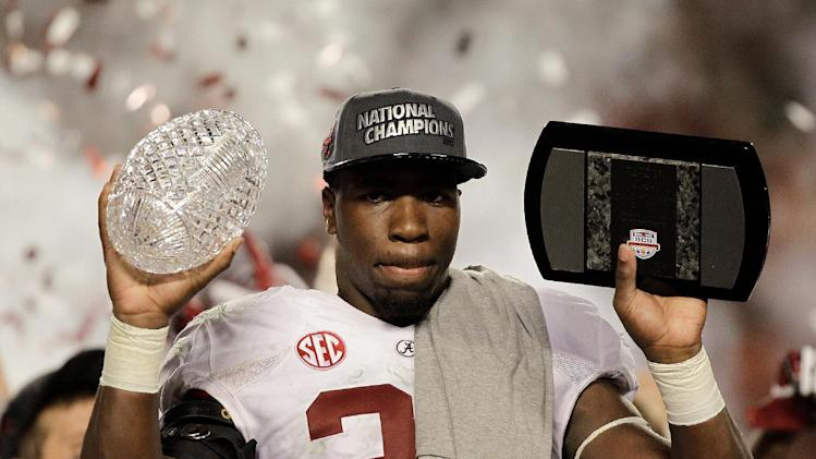 Alabama's C.J. Mosley holds up The Coaches' Trophy after the BCS National Championship college football game against Notre Dame Monday, Jan. 7, 2013, in Miami. Alabama won 42-14. (AP Photo/Chris O'Meara)