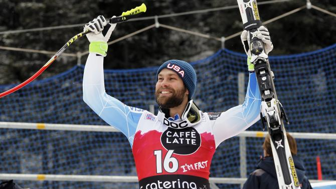 Travis Ganong reacts before the podium celebration after winning the men's World Cup Downhill skiing race in Santa Caterina