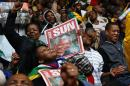 People sing and dance ahead of Mandela's national memorial service in Johannesburg