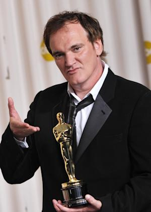 "Quentin Tarantino poses with his award for best original screenplay for ""Django Unchained"" during the Oscars at the Dolby Theatre on Sunday Feb. 24, 2013, in Los Angeles. (Photo by John Shearer/Invision/AP)"