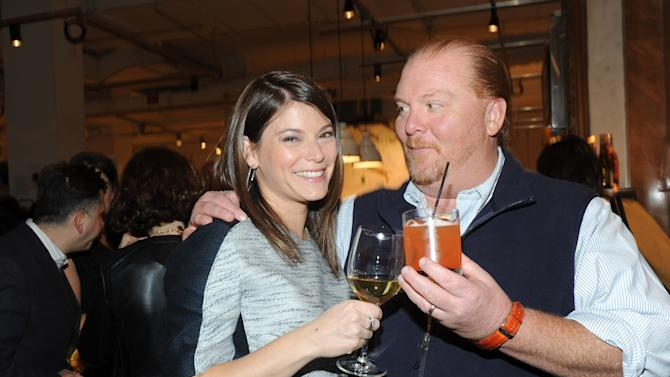 IMAGE DISTRIBUTED FOR FOOD & WINE - Gail Simmons, left, of FOOD & WINE and Bravo's Top Chef, toasts Mario Batali, the guest-editor of the April issue of FOOD & WINE, during a party at Eataly in New York, Wednesday, March 6, 2013.  (Photo by Diane Bondareff/Invision for FOOD & WINE/AP Images)
