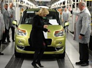 <p>Slovak Prime Minister Iveta Radicova visit the production line of Citroen C3 Picasso and Peugeot 207 cars at the company's factory in Trnava, Slovakia.</p>