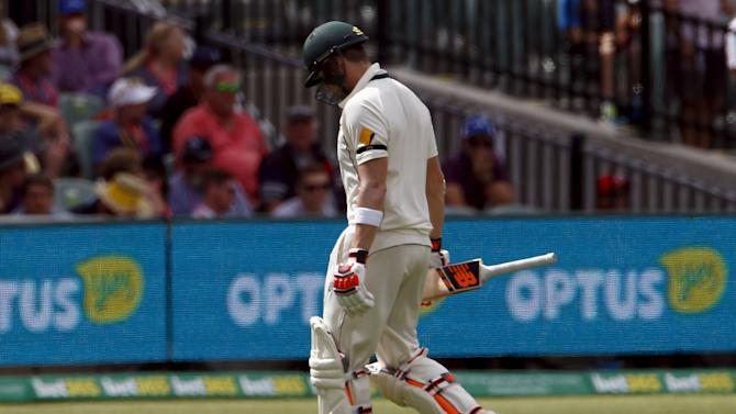 Australia's Smith reacts as he walks off the ground after being dismissed for 53 runs during the second day of the third cricket test match against New Zealand at the Adelaide Oval, in South Australia