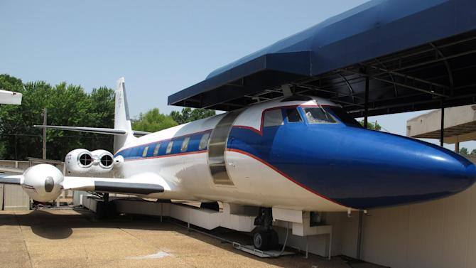 This photo taken on Tuesday, July 1, 2014, shows the Hound Dog II,, one of two jets once owned by late singer Elvis Presley, that is used as a tourist exhibit at the Graceland tourist attraction in Memphis, Tenn. The company that operates the Graceland tourist attraction has told the current owners of the Lisa Marie, and another plane called the Hound Dog II, that it wants the planes removed from Graceland by late April 2015, or shortly afterward. (AP Photo/Adrian Sainz)