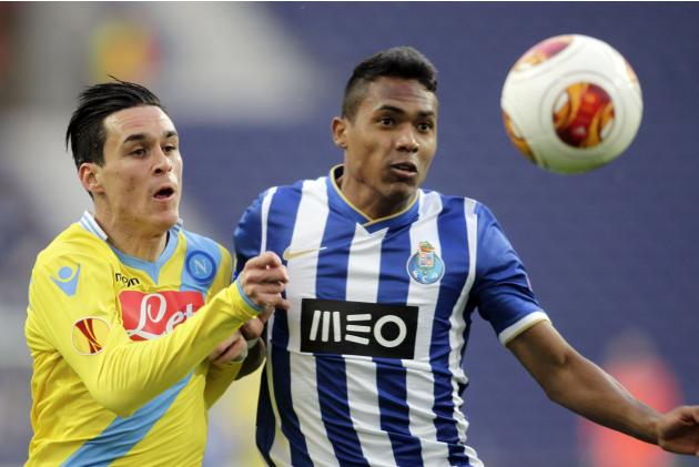 Porto's Alex Sandro battles for the ball with Napoli's Jose Maria Callejon during their Europa League round of 16 first leg soccer match at the Dragao stadium in Porto