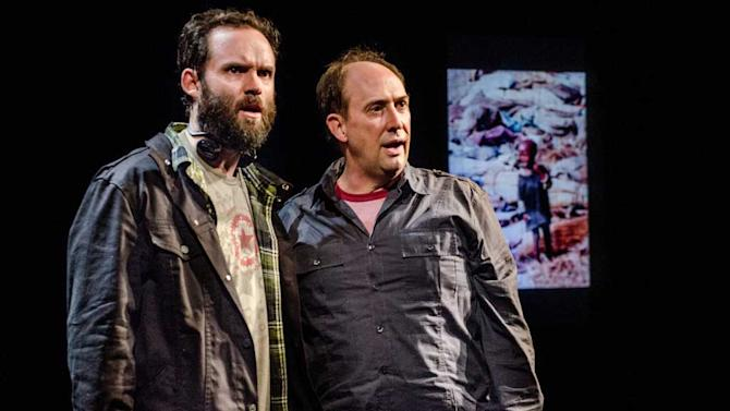 "This theater image released by Portland Center Stage via Columbia University  shows Danny Wolohan as Dan O'Brien, left, and William Salyers as Paul Watson during a performance of ""The Body of an American"" by Dan O'Brien. O'Brien's ""The Body of an American"" and Robert Schenkkan's ""All the Way"" have been named the inaugural winners of a theater award honoring the late Sen. Edward Kennedy. Columbia University on Friday said both playwrights will get the award as well as $100,000 each, one of the largest prizes given for dramatic writing.  (AP Photo/Portland Center Stage via Columbia University, Patrick Weishanpel)"