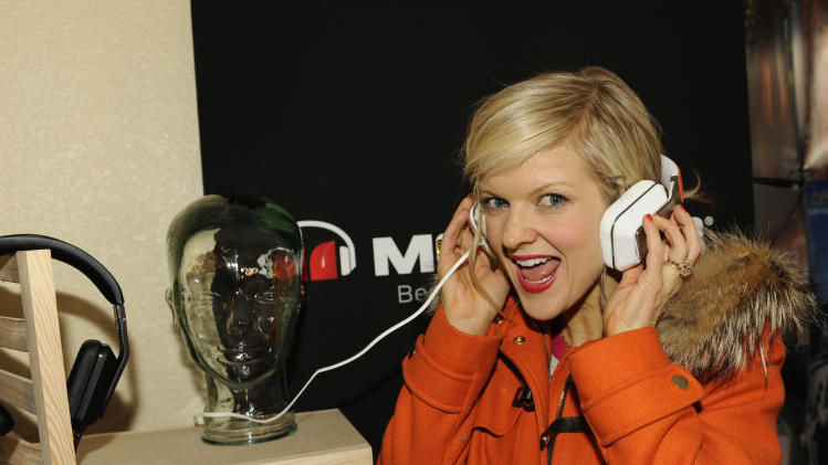 Actress Arden Myrin holds Inspiration headphones by Monster Products at the Fender Music lodge during the Sundance Film Festival on Monday, Jan. 21, 2013, in Park City, Utah. (Photo by Jack Dempsey/Invision for Fender/AP Images)