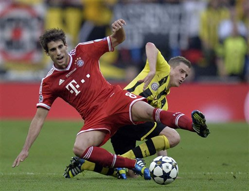 Bayern's Javi Martinez of Spain, vies for the ball with Dortmund's Sven Bender, during the Champions League Final soccer match between Borussia Dortmund and Bayern Munich, at Wembley Stadium in London