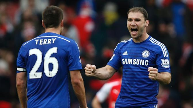 Chelsea's defenders John Terry (L) and Branislav Ivanovic react after the English Premier League football match between Arsenal and Chelsea at the Emirates Stadium in London on April 26, 2015