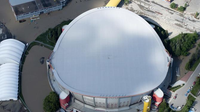 This aerial photo shows a flooded Calgary Saddledome in Calgary, Alberta, Canada on Saturday, June 22, 2013. The two rivers that converge on the western Canadian city of Calgary are starting to recede after floods devastated much of the southern Alberta province, causing at least three deaths and forcing thousands to evacuate. The flooding forced authorities to evacuate Calgary's entire downtown and hit some of the city's iconic structures hard. The Saddledome, home to the National Hockey League's Calgary Flames, was flooded up to the 10th row, leaving the dressing rooms submerged. (AP Photo/The Canadian Press, Jonathan Hayward)