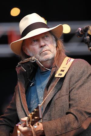 FILE - In this Oct. 24, 2010 file photo, Neil Young performs during the Bridge School Benefit concert in Mountain View, Calif. More than 60,000 people are expected to descend upon Central Park on Saturday evening, Sept. 29, 2012, for a free concert featuring the Black Keys and Young aimed at calling attention to poverty worldwide. (AP Photo/Tony Avelar, File)