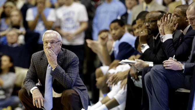 North Carolina coach Roy Williams watches from the sideline during the second half of an NCAA college basketball game against Miami in Chapel Hill, N.C., Wednesday, Jan. 8, 2014. Miami won 63-57. (AP Photo/Gerry Broome)