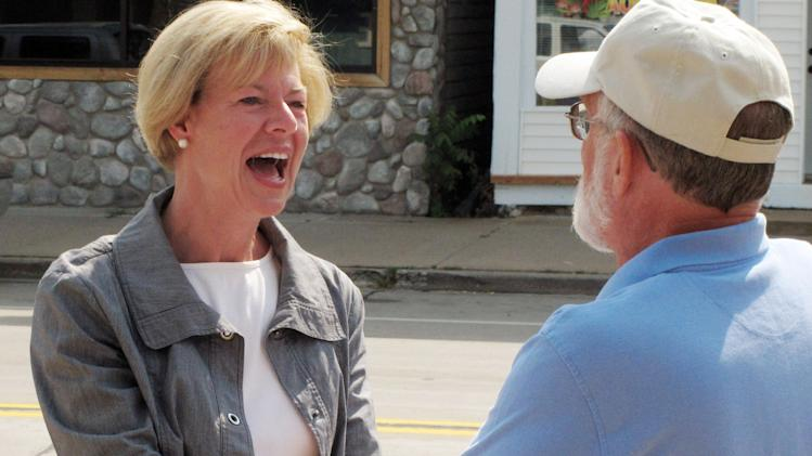 FILE - In this July 5, 2012 file photo, Democratic U.S. Rep. Tammy Baldwin, who is running for Wisconsin's open U.S. Senate seat, meets with voters in Friendship, Wis. Democrats are looking to Baldwin to stem a long and deep losing streak that dates back to 2010 when Republicans took control of both houses of the Legislature, Scott Walker was elected governor and tea party favorite Ron Johnson knocked off incumbent Sen. Russ Feingold. (AP Photo/Scott Bauer, File)