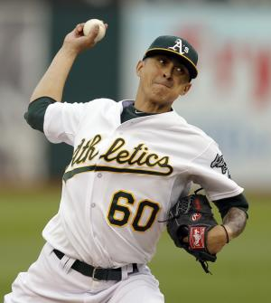 Chavez strikes out 9, A's beat Giants 5-0