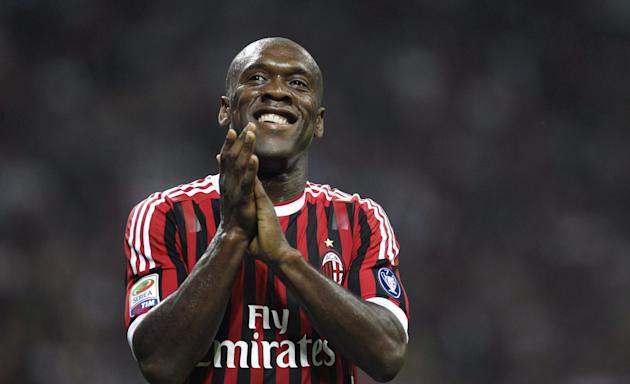 In this Saturday, May 14, 2011 photo AC Milan midfielder Clarence Seedorf, of the Netherlands, smiles during a Serie A soccer match between AC Milan and Cagliari at the San Siro stadium in Milan, Ital