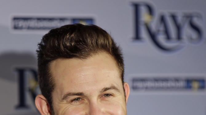 Tampa Bay Rays third baseman Evan Longoria smiles as he answers questions during a news conference after signing a six-year, $100 million, contract extension Monday, Nov. 26, 2012, in St. Petersburg, Fla. Longoria is signed with the Rays through the 2022 season. (AP Photo/Chris O'Meara)