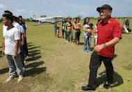Philippine Congressman Walden Bello, right, walks past local residents and municipal employees of Pagasa Island, part of the disputed Spratly group of islands, in the South China Sea located off the coast of western Philippines Wednesday, July 20, 2011. China protested a trip made by Filipino lawmakers to disputed areas in the South China Sea to assert the claim of the Philippines. Ethan Sun, spokesman for the Chinese embassy in Manila, said the trip scheduled was &#39;against the spirit&#39; of a code of conduct signed by claimants to the areas in 2002. The Spratlys, believed to be rich in oil, mineral and marine resources, are also claimed in whole or partly by Brunei, Malaysia, Vietnam and Taiwan. (AP Photo/Rolex Dela Pena, Pool)