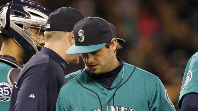 Seattle Mariners relief pitcher Lucas Luetge comes out against the Los Angeles Dodgers in the eighth inning of a baseball game Friday, June 8, 2012, in Seattle. The Mariners won 1-0 in a six-pitcher combined no-hitter. (AP Photo/Elaine Thompson)