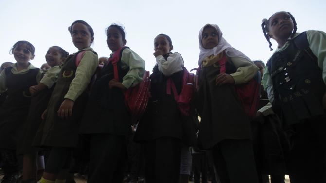 Students line up on the first day of their new school year at a government school in Giza